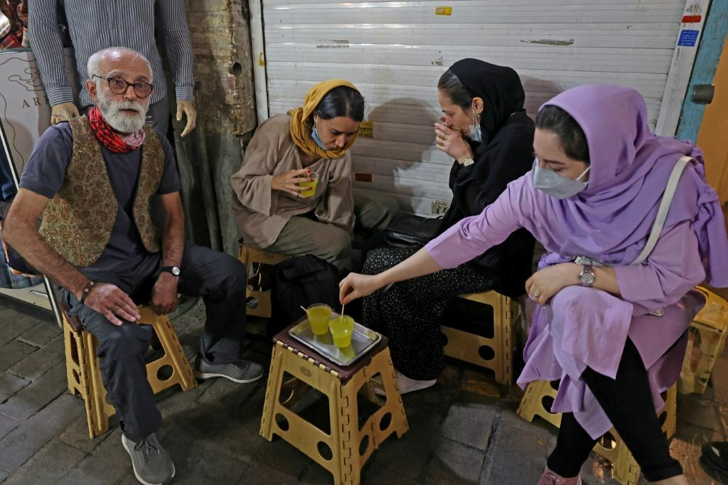 Given the miniature size of the teahouse, there are no tables, but customers can pull up a plastic stool outside, amid the bazaar's bustle