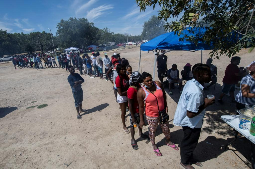 Haitian migrants queue for food in the Mexican city of Ciudad Acuna