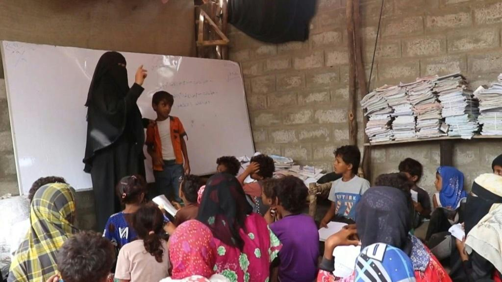 In a remote village in the southern Yemeni province of Hodeida, teacher Amina Mahdi gives a science lesson to children sprawled across the ground at her home, providing their only opportunity for an education in the rural area