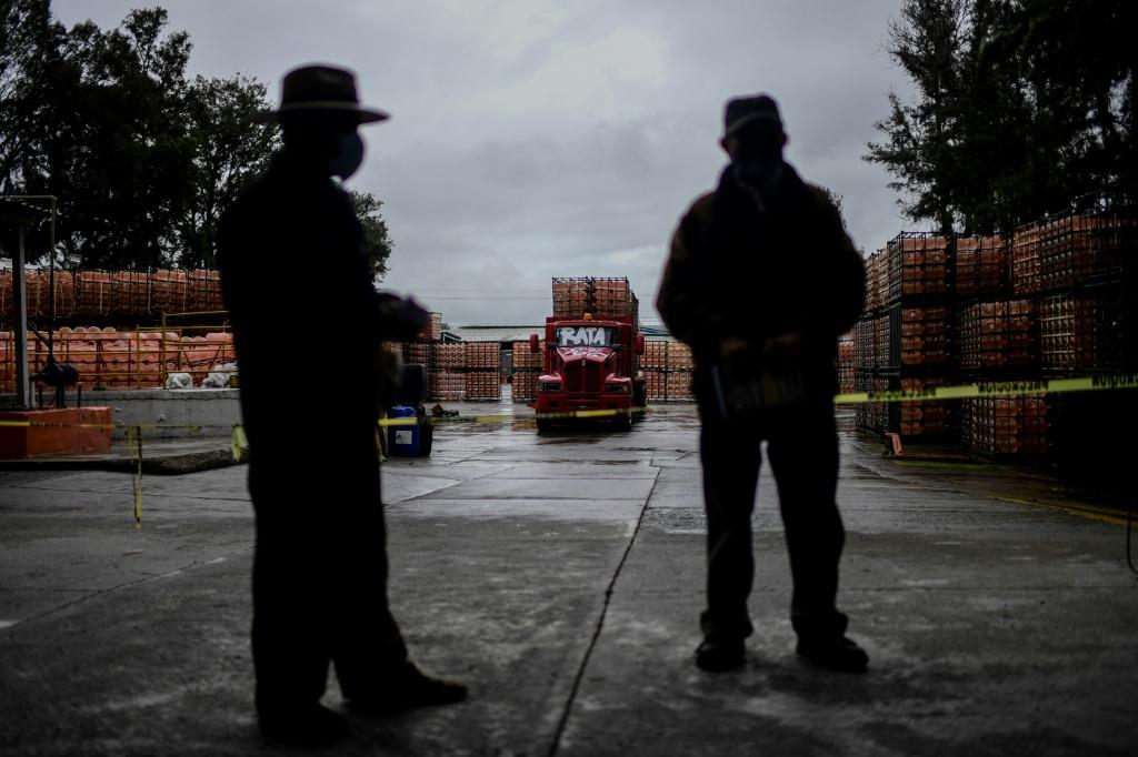 Members of Mexico's indigenous communities guard a bottling plant they have occupied in the central state of Puebla