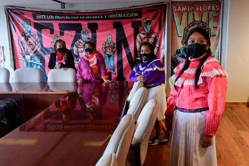Mexican woman from the Otomi indigenous community are seen in the occupied National Institute of Indigenous Peoples building in Mexico City