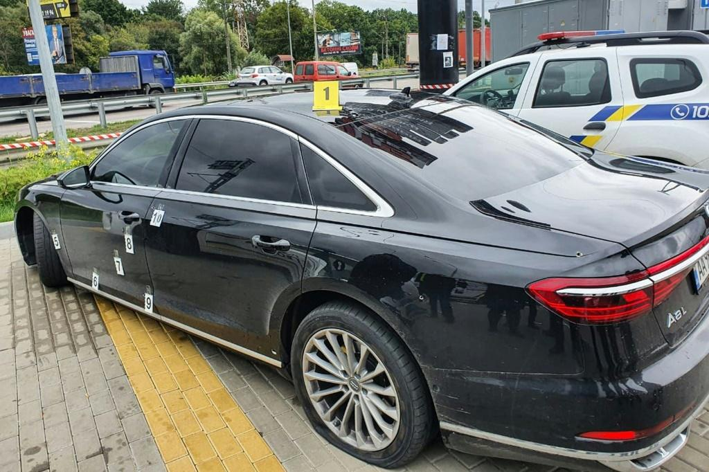 Photos published by officials showed a black Audi with bullet holes along its bonnet and on the driver-side door