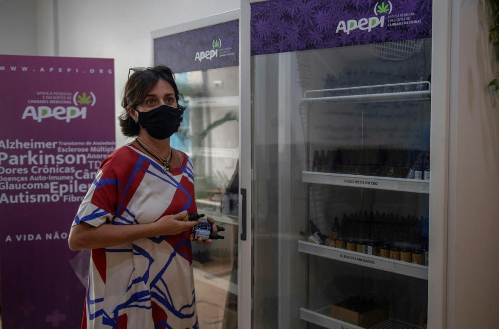 Brazilian lawyer and founder of the Medical Cannabis Research and Patient Support Association (Apepi) Margarete Brito shows a fridge containing medicinal cannabis oil at Apepi headquarters