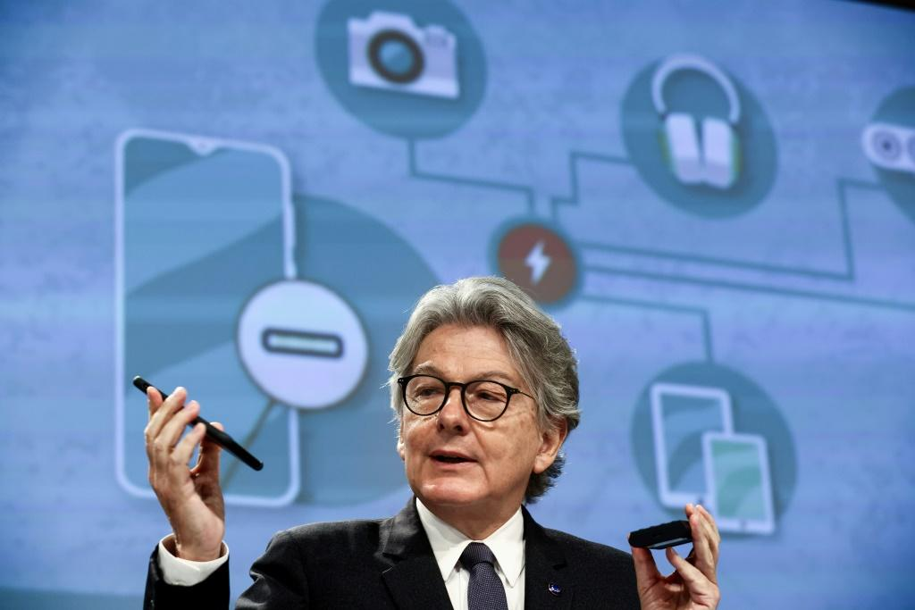 EU internal market commission Thierry Breton shows his phone as Brussels seeks to impose a universal charger
