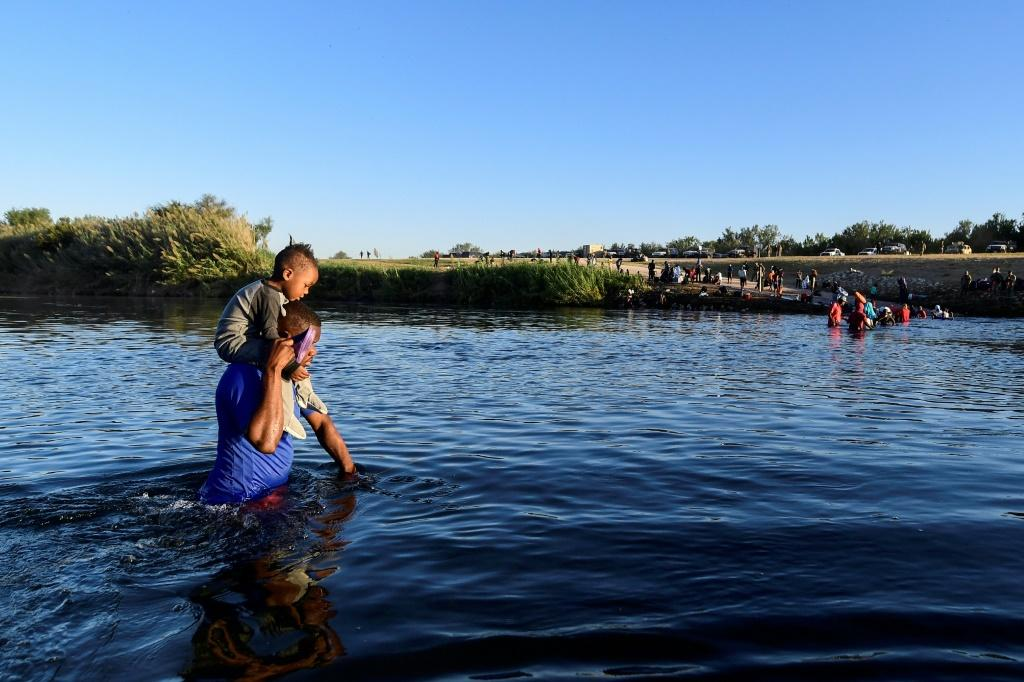 Haitian migrants cross the Rio Grande river from Ciudad Acuna, Mexico, to the United States.