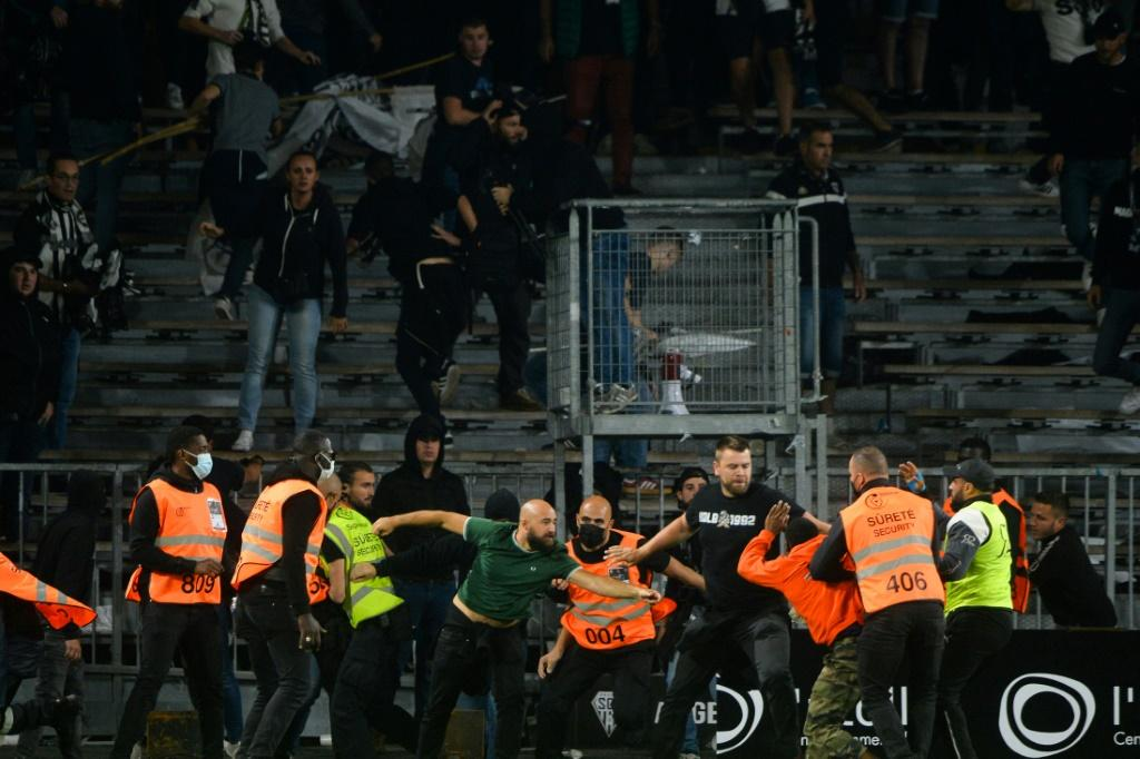 Marseille supporters clashed with opposing fans and security staff at Angers' stadium
