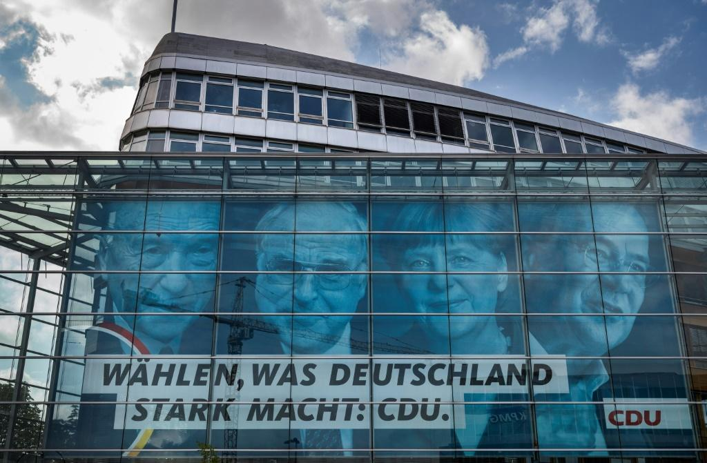 The CDU is portraying Armin Laschet (right) as the candidate to ensure continuity and cement Merkel's legacy