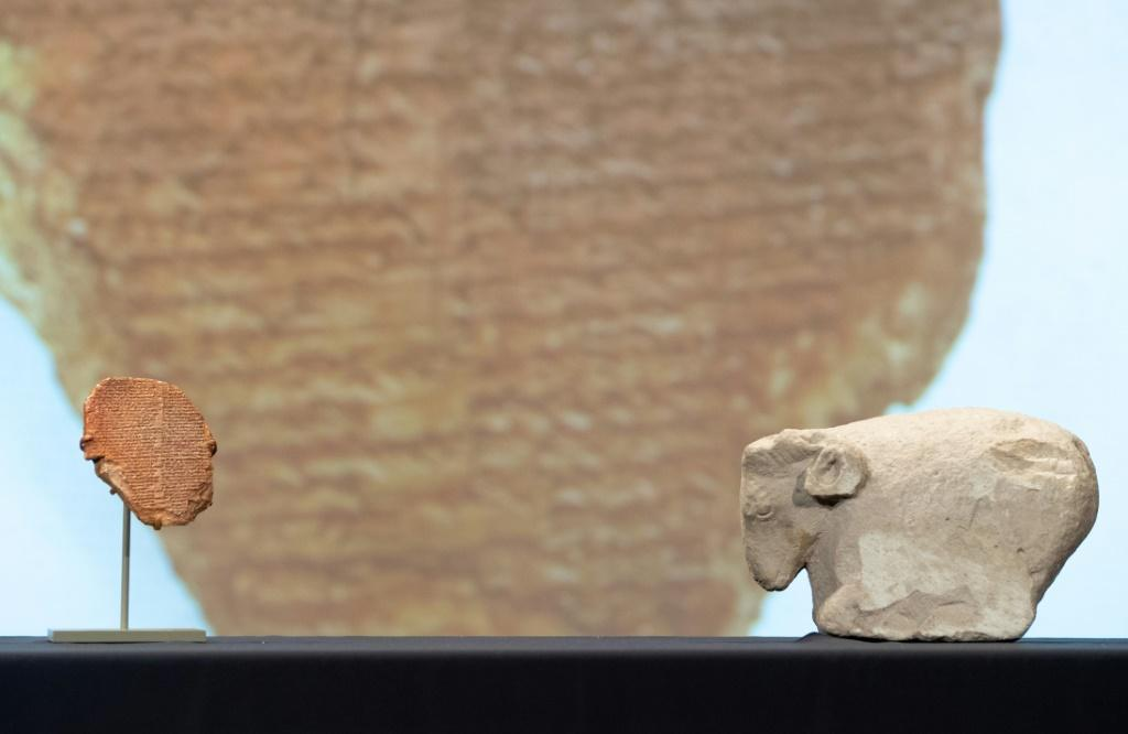 The tablet of Gilgamesh and a 5,000-year-old sculpture of a sheep are displayed September 23, 2021 in Washington, DC