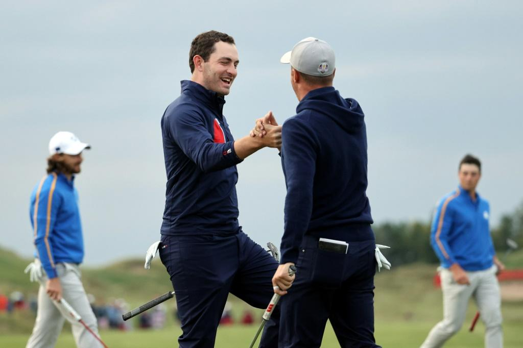 Americans Justin Thomas and Patrick Cantlay celebrate as they rally to tie Europe's Tommy Fleetwood and Viktor Hovland in a Ryder Cup four-balls at Whistling Straits