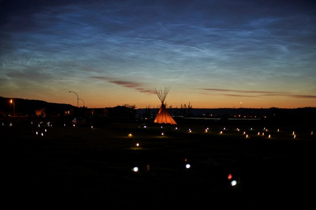 Solar lights and flags mark where 751 human remains were discovered in unmarked graves at the site of the former Marieval Indian Residential School in Saskatchewan, Canada in June 2021