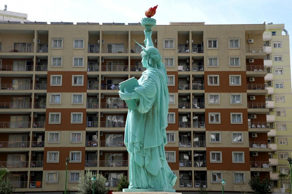 The exiles living at the expense of US NGOs and the Albanian government -- in a hotel featuring a replica of the Statue of Liberty