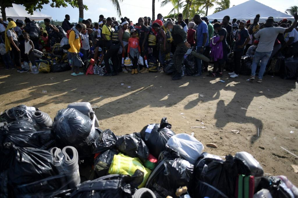 The migrants are waiting for limited places on a boat to Acandi, on the Panama border