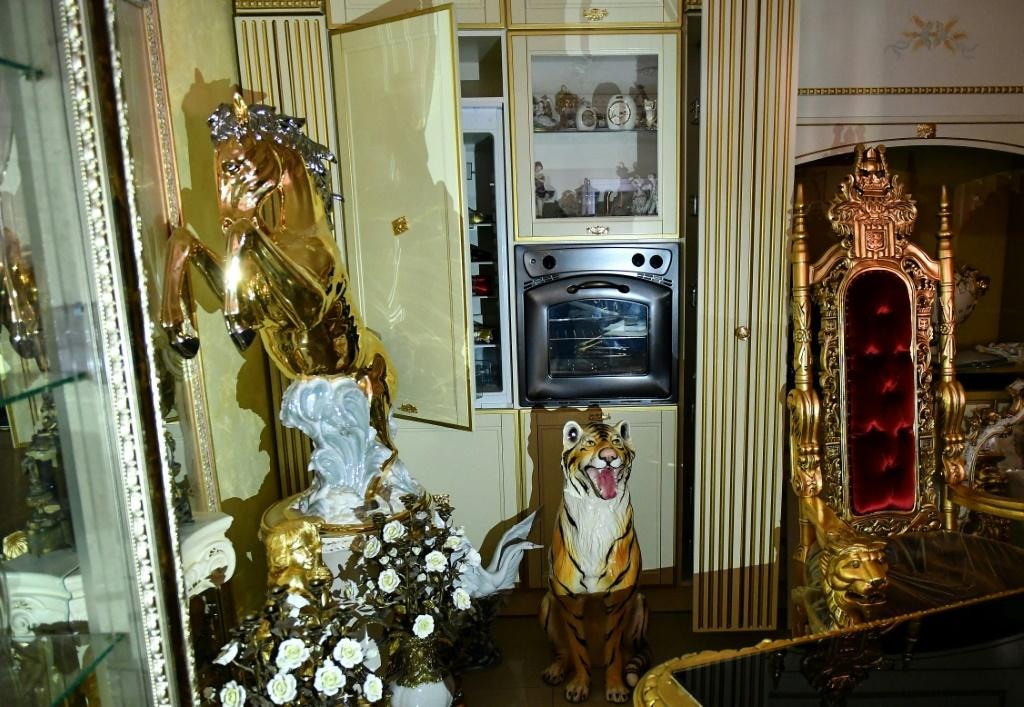 The villas revealed the 'eccentric aesthetic taste' of a clan of particularly fierce loan sharks with a penchant for bling