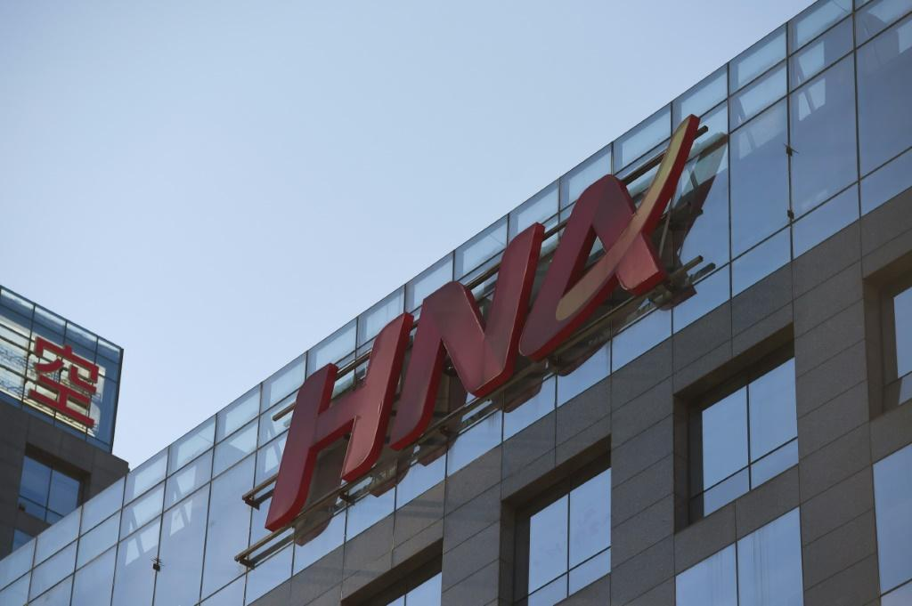 Two top executives of China's HNA Group have been detained