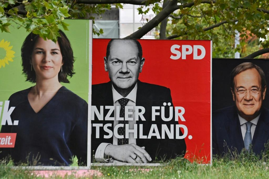 Billboards with election campaign posters showing the three chancellor candidates in the the September 26 federal election