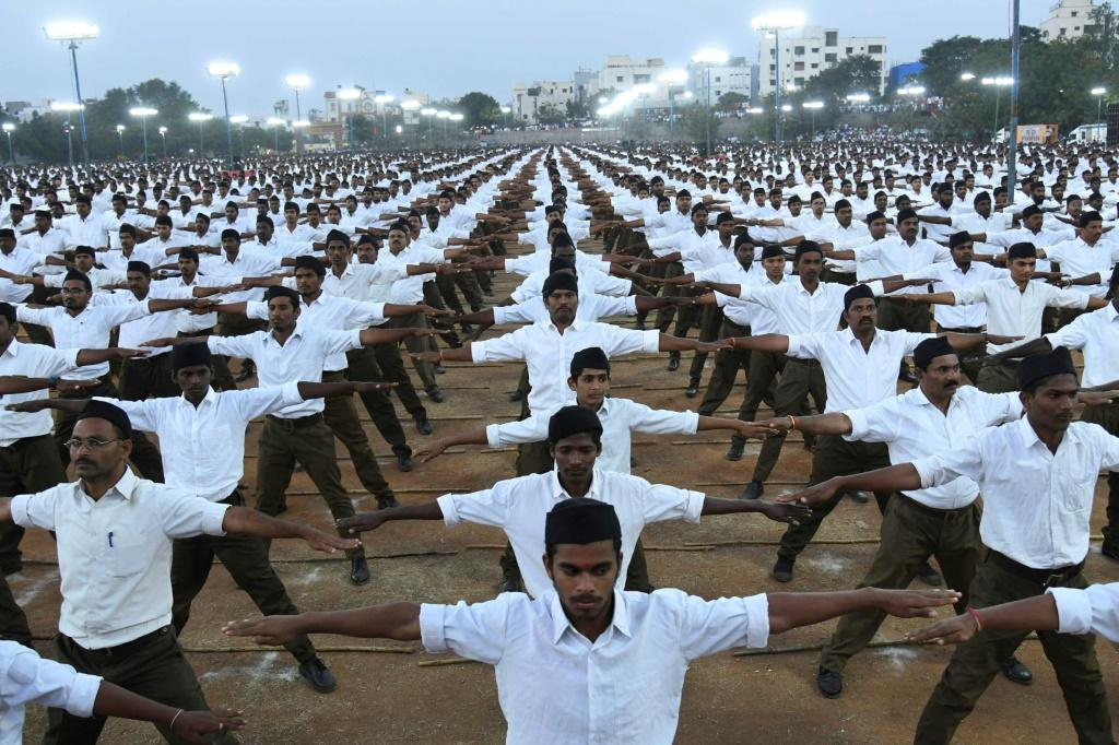 Members of the Rashtriya Swayamsevak Sangh participate in a rally in support of India's controversial citizenship law on the outskirts of Hyderabad on December 25, 2019