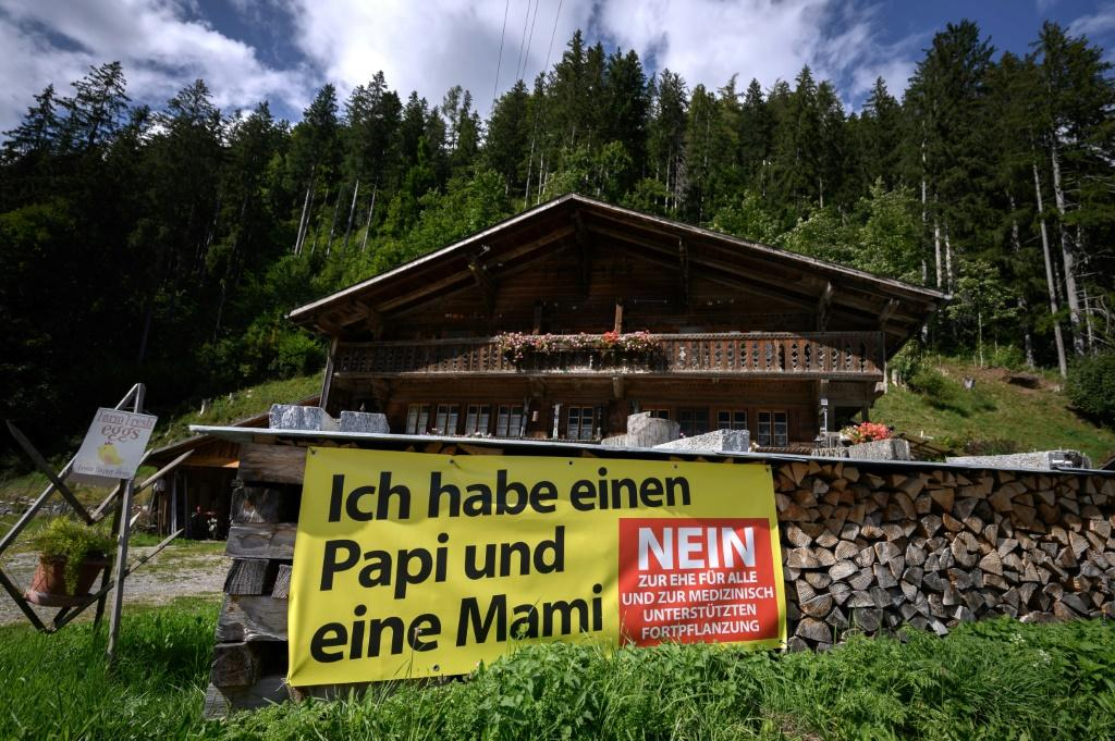 """A banner in the western town of Jaun urges Swiss to vote against marriage for all -- the message reads """"I have a Daddy and Mummy"""