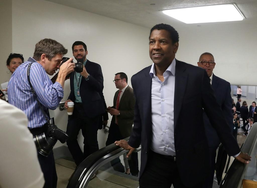 Actor Denzel Washington, pictured in 2018 after riding the Capitol Subway, is a among a long list of celebrity patrons that also includes Richard Gere, Chuck Norris, Jon Stewart and the rock star Bono