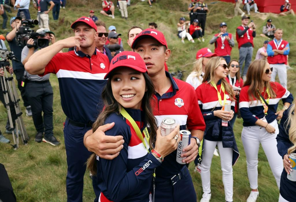 American Collin Morikawa and girlfriend Katherine Zhu along with Bryso DeChambeau and other US teammates celebrate their win over Europe at the 43rd Ryder Cup