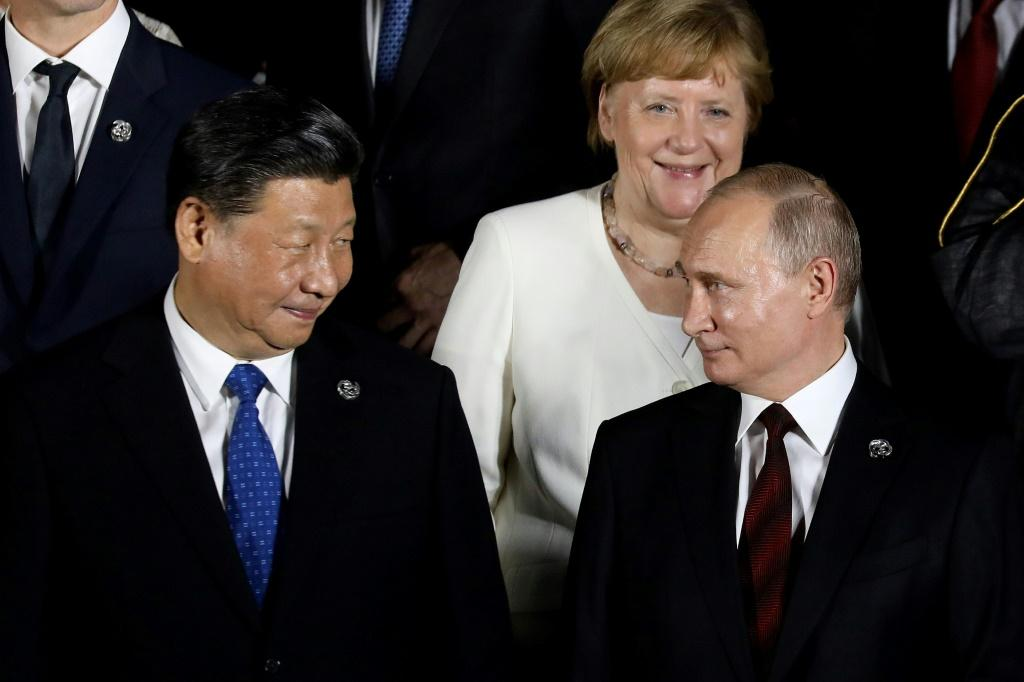 Many hail Merkel as a welcome counterbalance to the big, brash men of global politics