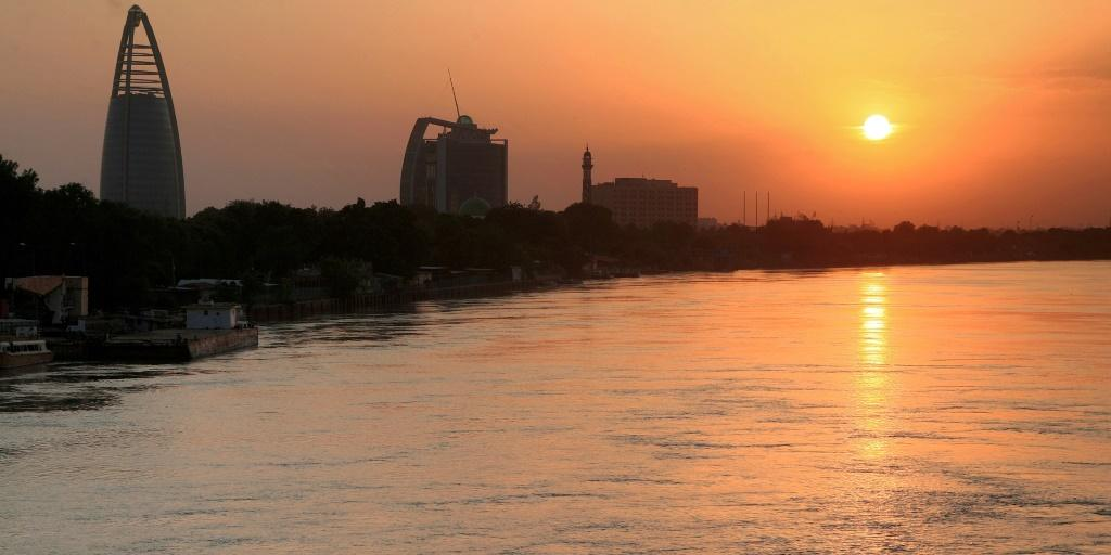 The Greater Nile Petroleum Oil Company (GNPOC) Tower and PetroDar Operating Company (PDOC) Tower (left to right) near the Blue Nile riverfront in Sudan's capital Khartoum at sunset