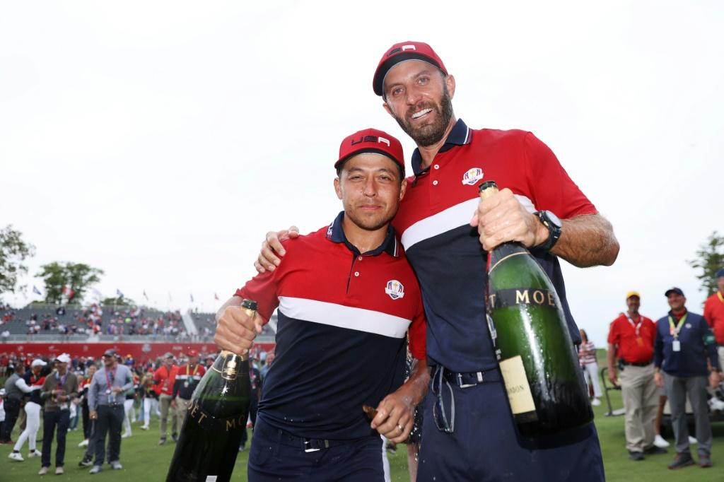 Winners: Dustin Johnson and Xander Schauffele celebrate the United States' 19-9 rout of Europe in the 143rd Ryder Cup