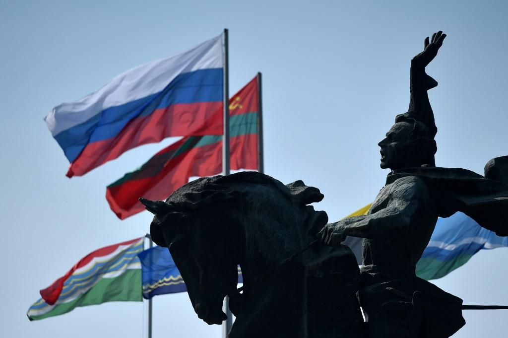 Flags of Russia and Transnistria -- which professes allegiance to Moscow -- flutter by a monument to 18th century Russian military commander Alexander Suvorovin in Tiraspol