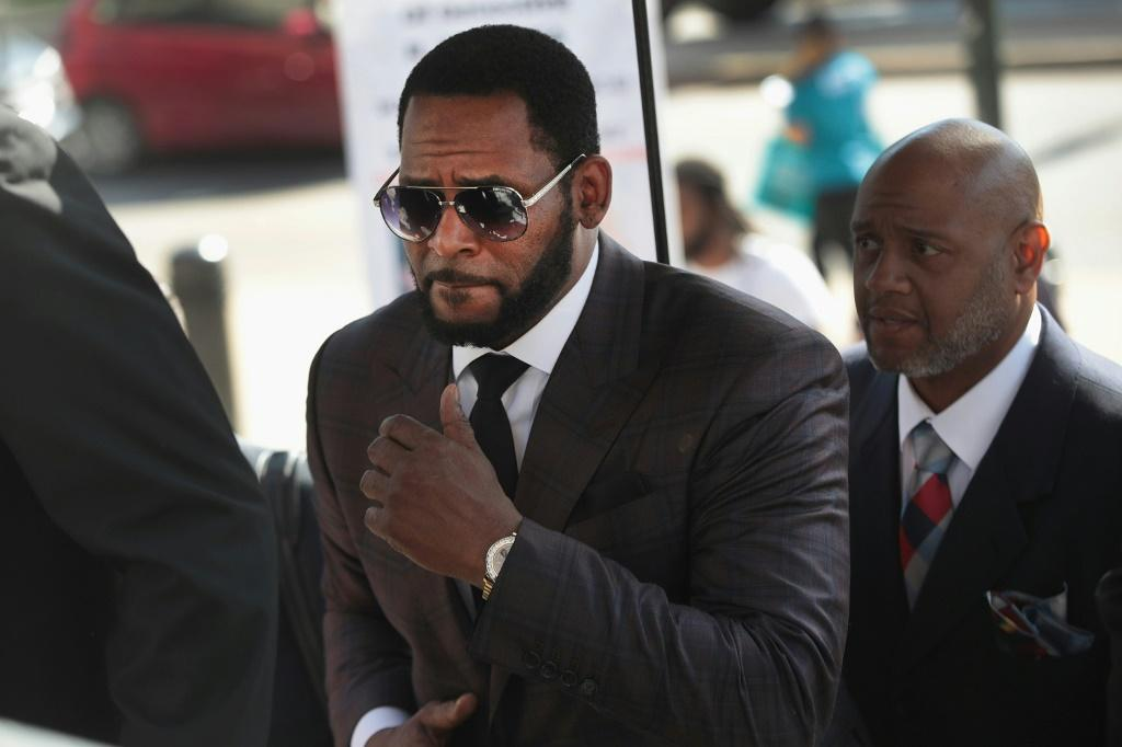 R&B singer R. Kelly, pictured arriving at the Leighton Criminal Courts Building for a hearing in Chicago, Illinois in 2019, faces life in prison after he was found guilty of racketeering and sex abuse charges in a New York court