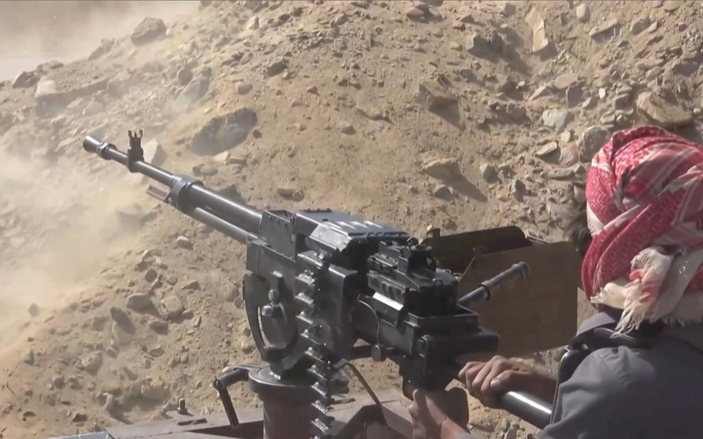 A grab from an AFPTV video shows a Yemeni pro-government fighter firing at positions of the Iran-backed Huthi rebels as they inch closer to the loyalists' last northern bastion, the strategic city of Marib, on September 27