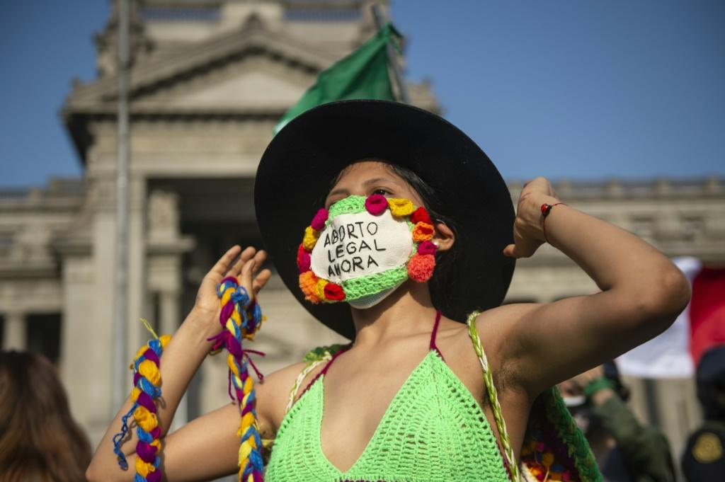 Activists demanding abortion rights rally outside the Justice Palace in Lima