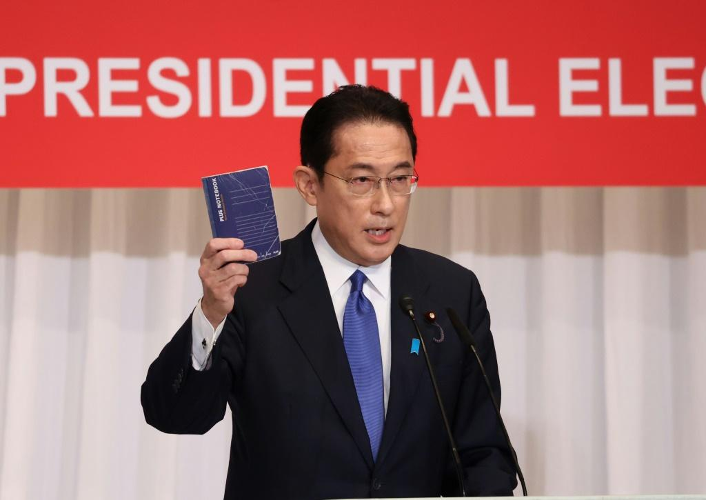 Former LDP policy chief Fumio Kishida carries around a notebook with suggestions from the public