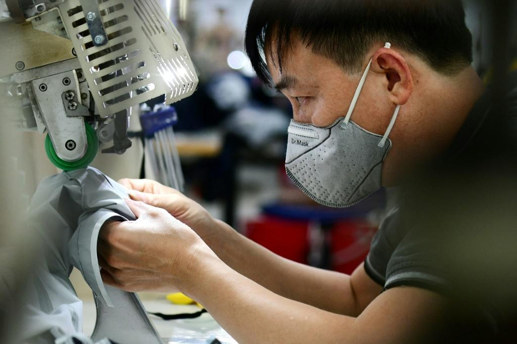 The snarl-ups at Vietnam's factories are part of a global crisis that is sending inflation surging and raising concerns about the pandemic recovery