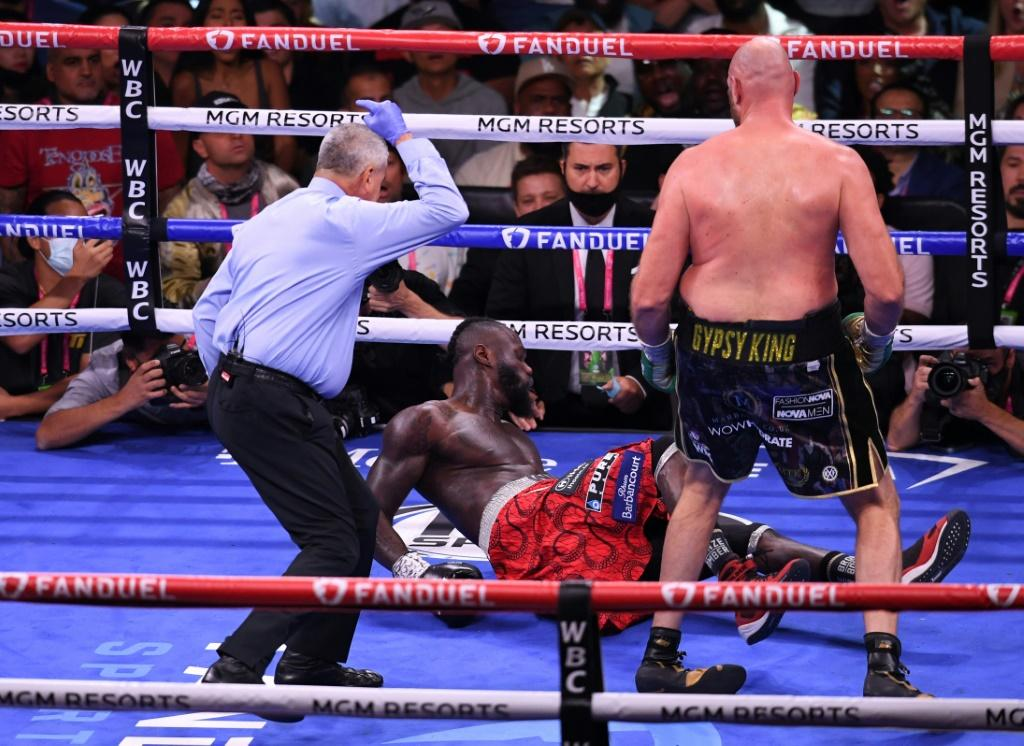 Tough man: US challenger Deontay Wilder is knocked down by WBC heavyweight champion Tyson Fury of Britain as they fight for the WBC Heavyweight title in Las Vegas
