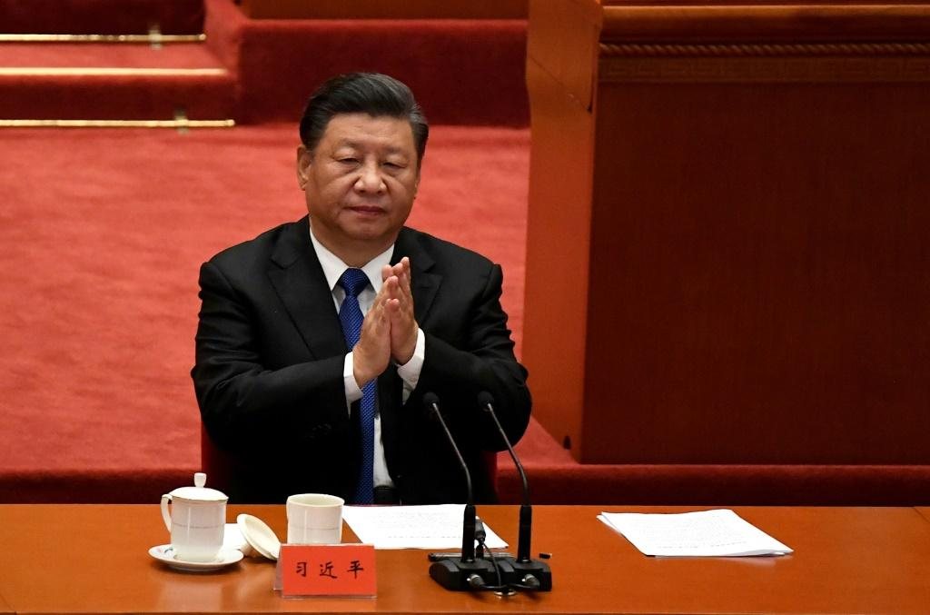 Chinese President Xi Jinping marks the 110th anniversary of the overthrow of the Qing Dynasty, which prompted the founding of the Republic of China, at the Great Hall of the People in Beijing on October 9, 2021