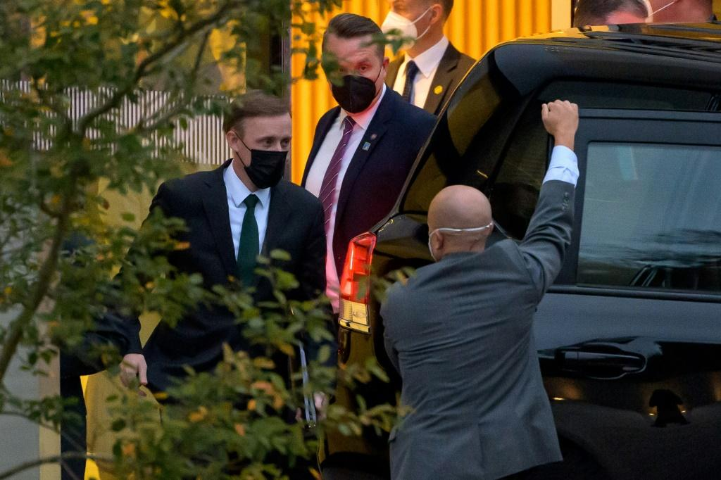 US National Security Advisor Jake Sullivan (L) leaves the Hyatt hotel in Zurich where top US and Chinese officials held talks on October 6, 2021