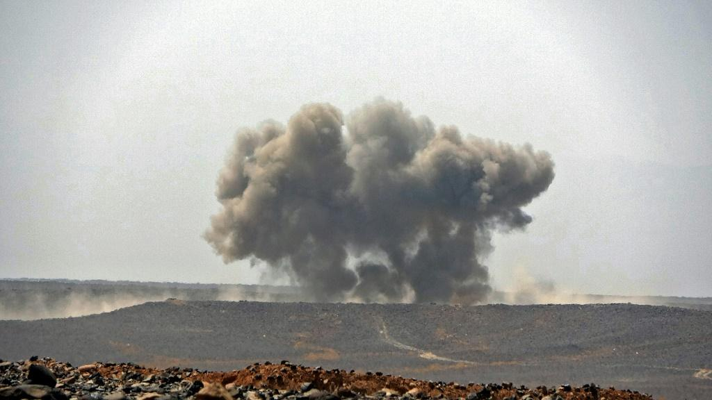 A picture taken on March 5, 2021 shows smoke billowing during clashes between forces loyal to Yemen's Saudi-backed government and Huthi rebel fighters in Marib province