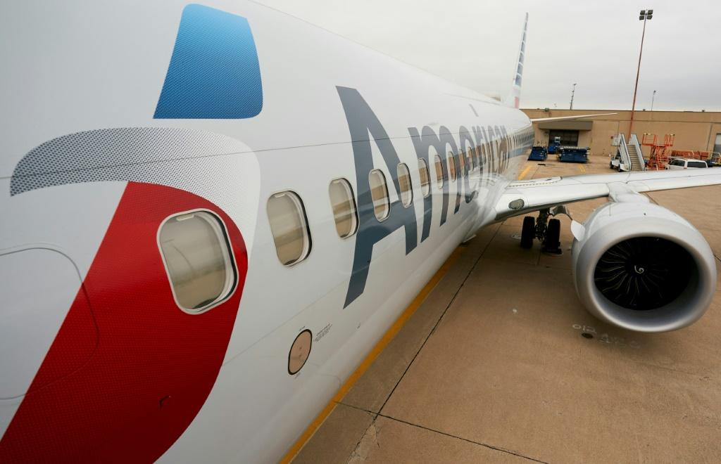 American Airlines said it will defer to federal law over the Texas state law on employer vaccine mandates
