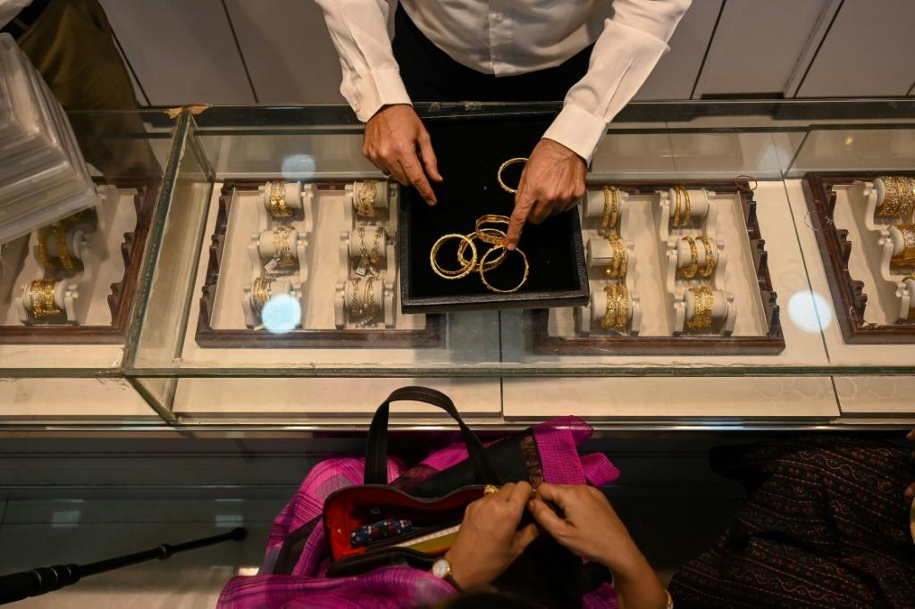 Desperate families and firms have been forced to put up gold jewellery as collateral to secure short-term loans, with banks lending 4.71 trillion rupees ($64 billion) in the first eight months of the year, a 74 percent rise year on year