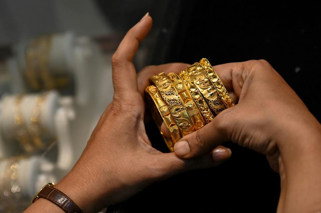 While the economy is recovering, many indians are still struggling financially, forcing them to sell their most cherished asset -- gold