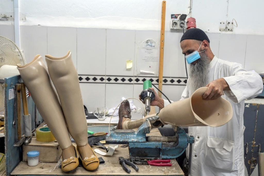 A technician works on prosthetic leg at the International Committee of Red Cross Rehabilitation Centre in Kabul
