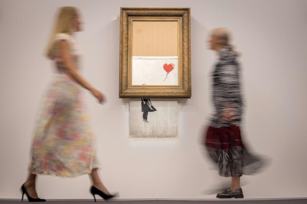 Banksy's partially shredded canvas is expected to sell for between £4-6 million ($6-8 million, 5-7 million euros)
