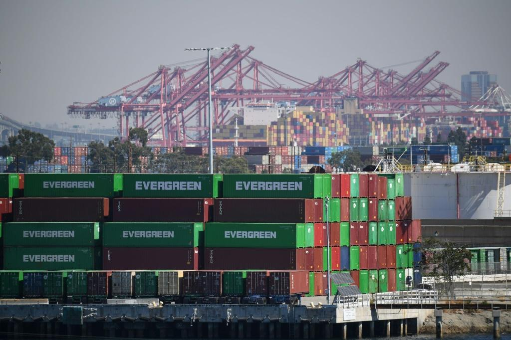 Containers and cranes are seen at the Port of Los Angeles, in California on October 13, 2021