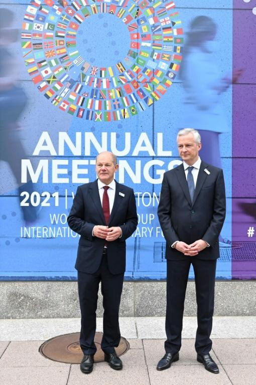 French Finance Minister Bruno Le Maire (right) speaks with German Finance Minister Olaf Scholz (left) outside IMF headquarters in Washington