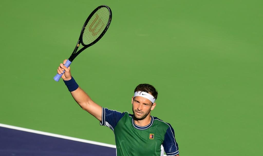 Grigor Dimitrov of Bulgaria celebrates victory over top-seeded Daniil Medvedev of Russia in the fourth round of the ATP Indian Wells Masters