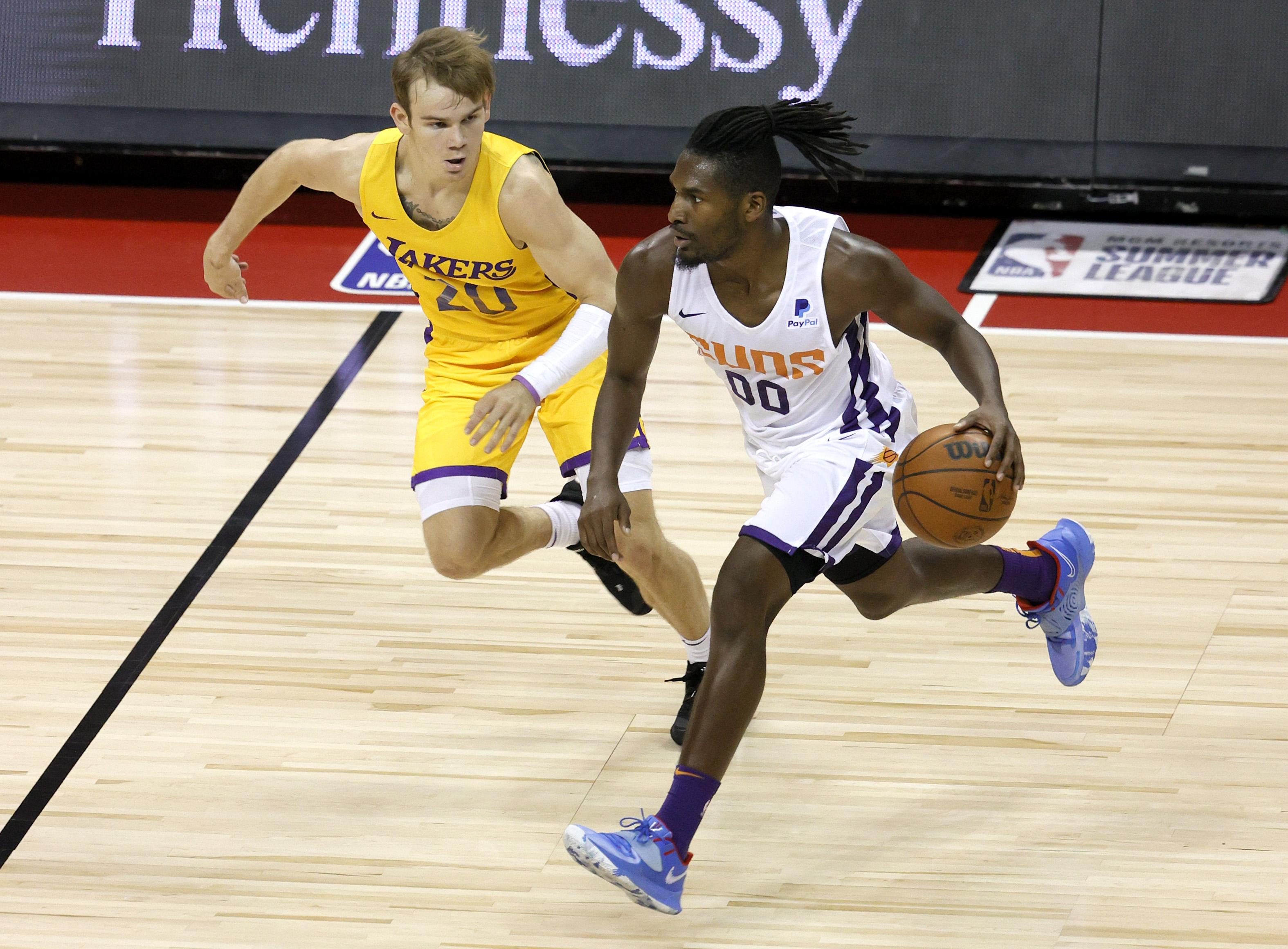 Jaleen Smith #00 of the Phoenix Suns brings the ball up the court against Mac McClung #20 of the Los Angeles Lakers