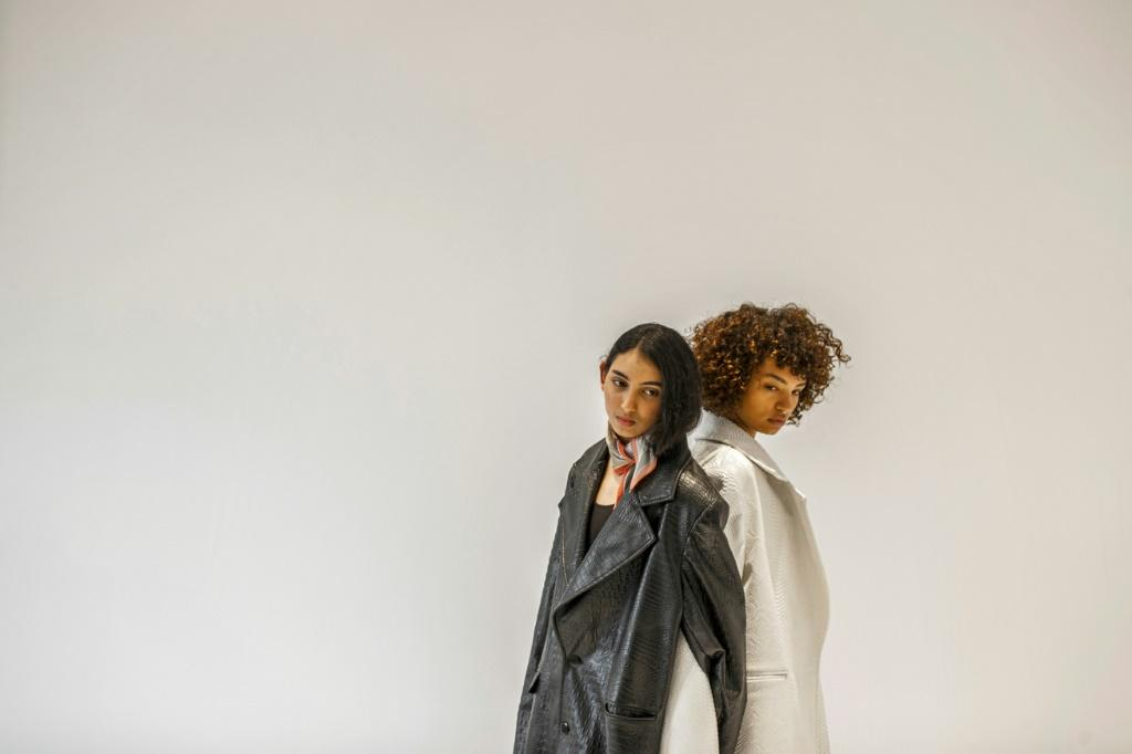 (L to R) Egyptian fashion models Zeina Ehab and Mariam Abdallah pose during a photo session at the UNN Model Management agency's studio in Cairo