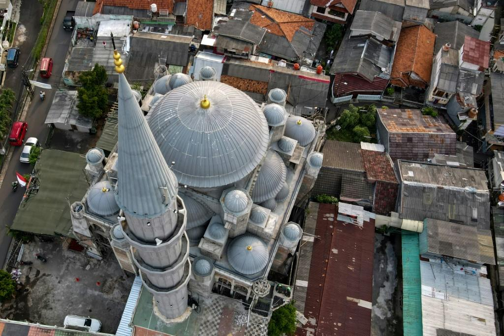 There are around 750,000 mosques across Indonesia -- a medium sized venue could have at least a dozen external loudspeakers that blare the call to prayer five times a day