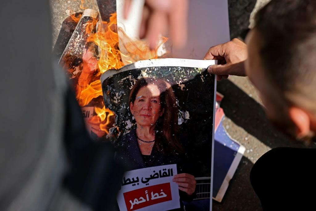 A Shiite protester burns a portrait of US ambassador Dorothy Shea at a rally near the Palace of Justice in the Lebanese capital