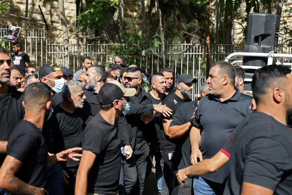 Supporters of Shiite groups Hezbollah and Amal demonstrate outside Lebanon's Palace of Justice demanding the replacement of the lead investigator into last year's monster Beirut port explosion