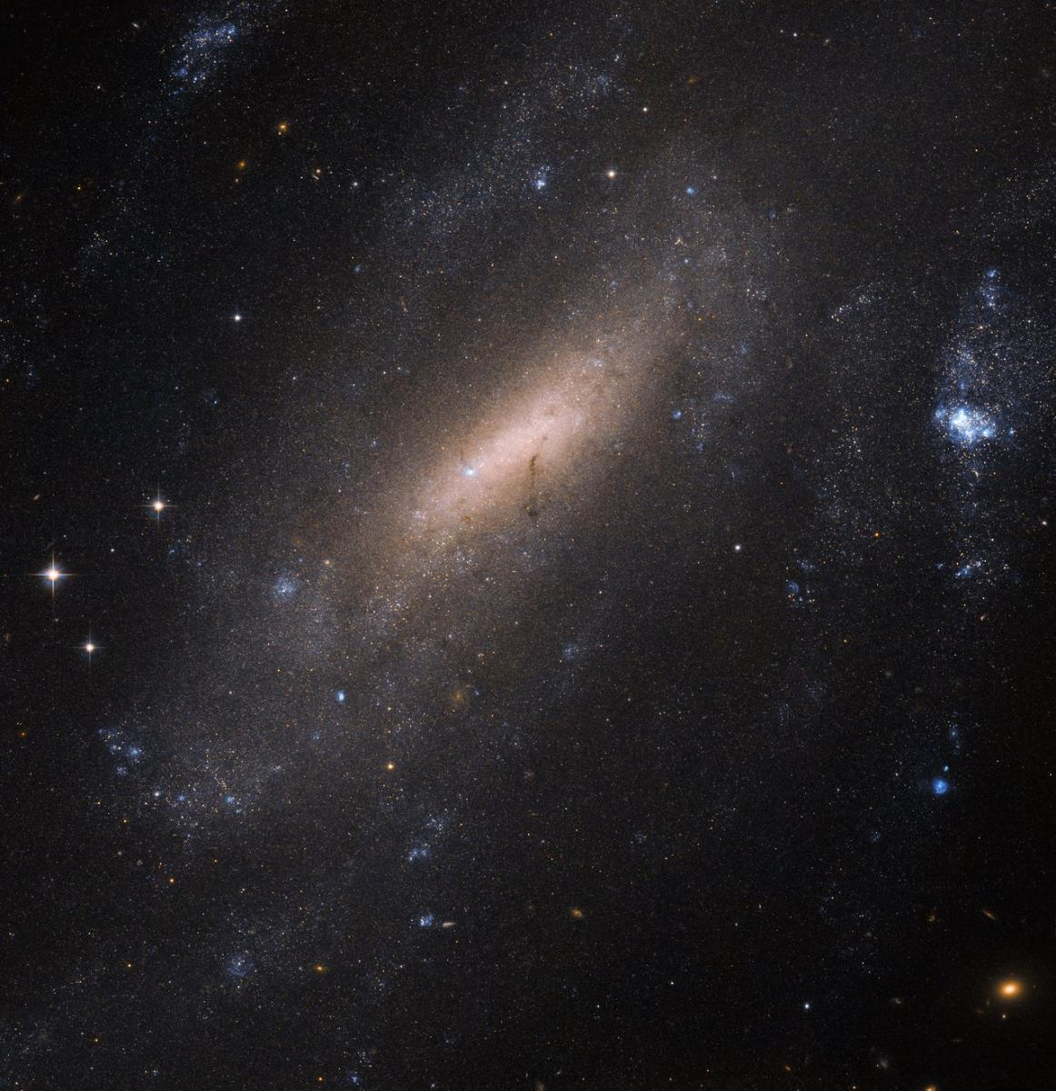 Hubble Space Telescope Photographs IC 5201 — A Distant Barred Spiral Galaxy